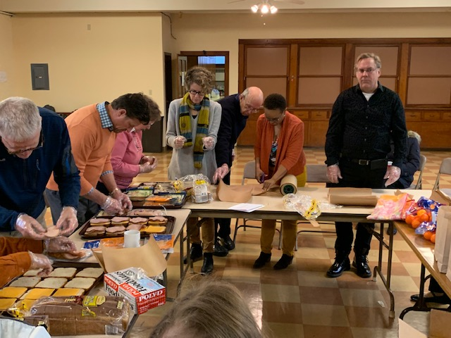 Church members make sandwiches to deliver to people experiencing homelessness in Cleveland.